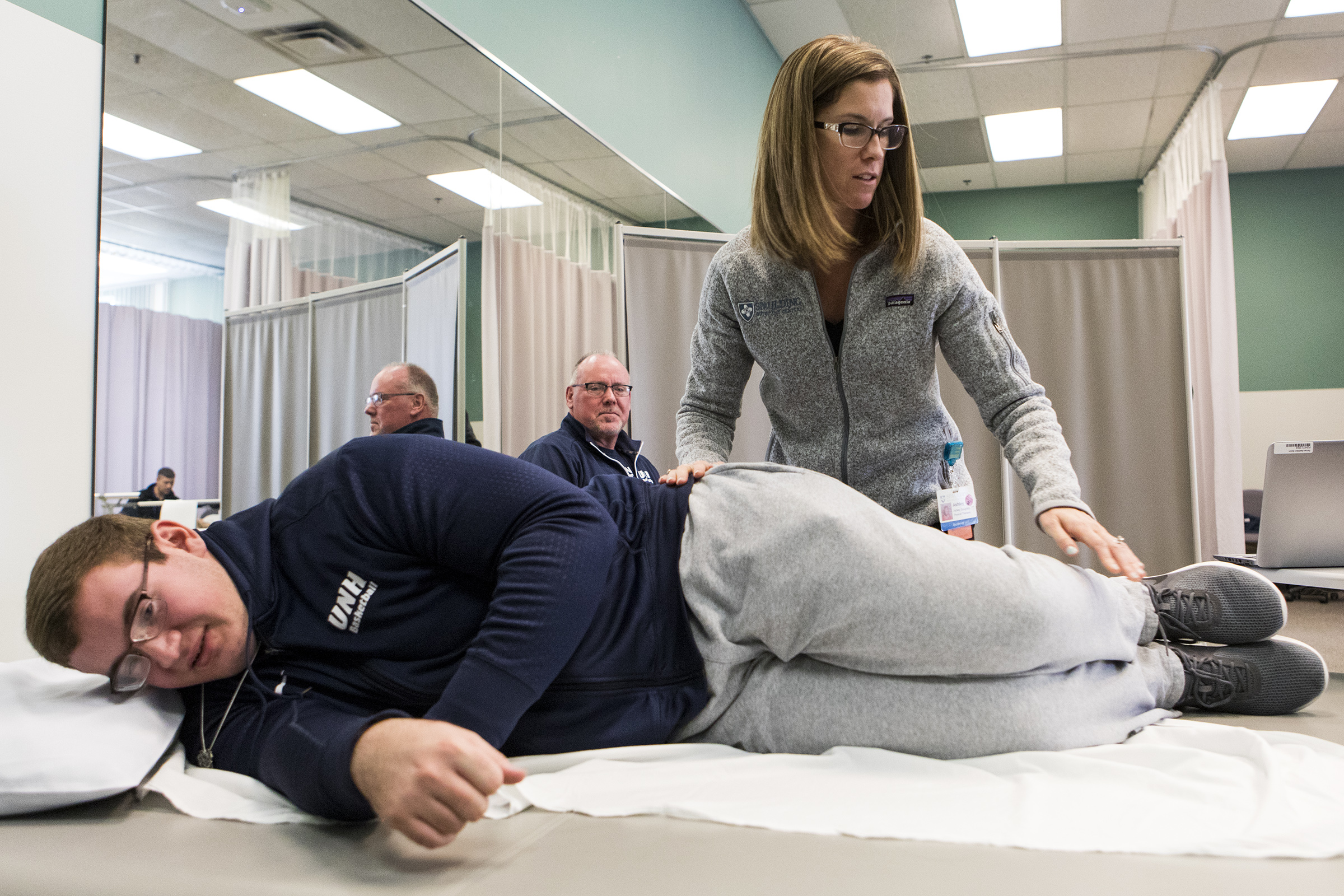 Robbie Walker watches as physical therapist Ashley Soughley gives his son Connor an exam at Spaulding Outpatient Center in Framingham on Oct. 31, 2018.
