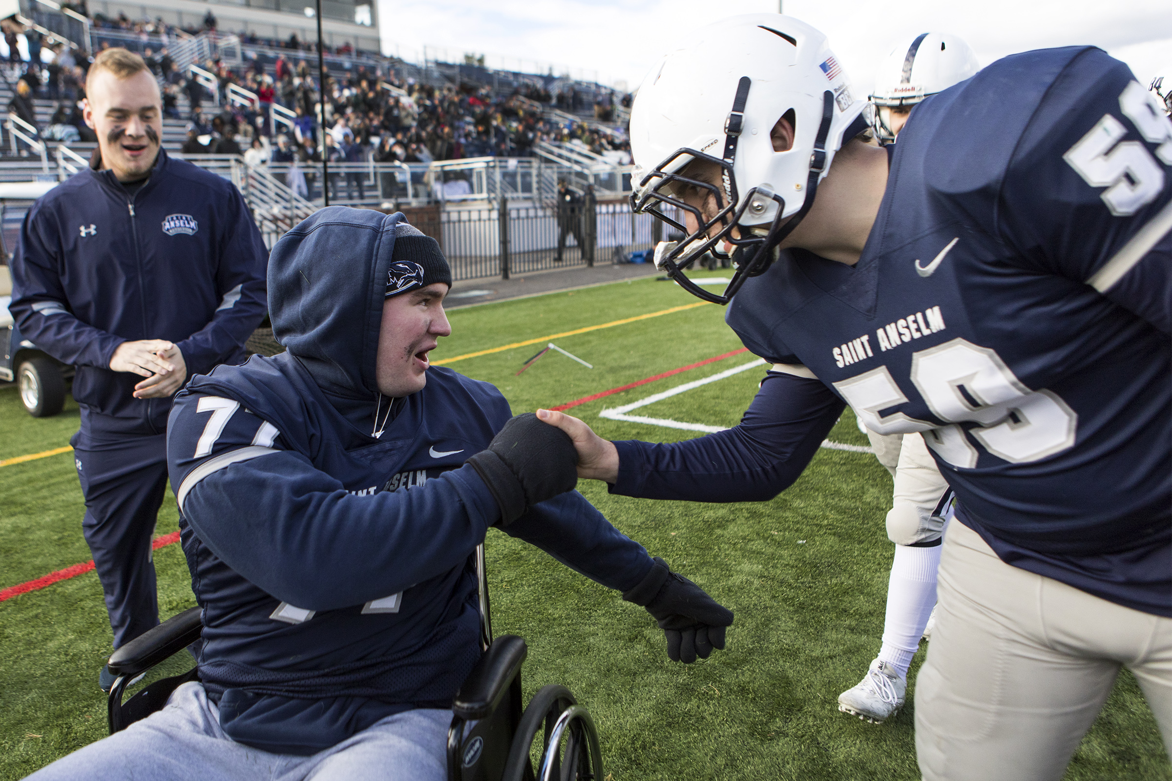 Connor greets his teammate Luke Hufnagle during their final football game of the season at Saint Anselm College in Manchester, New Hampshire, on Nov. 10, 2018. Even after suffering a spinal cord injury on the field, Connor said it was one of the hardest decisions of his life not to return to the game he loved.