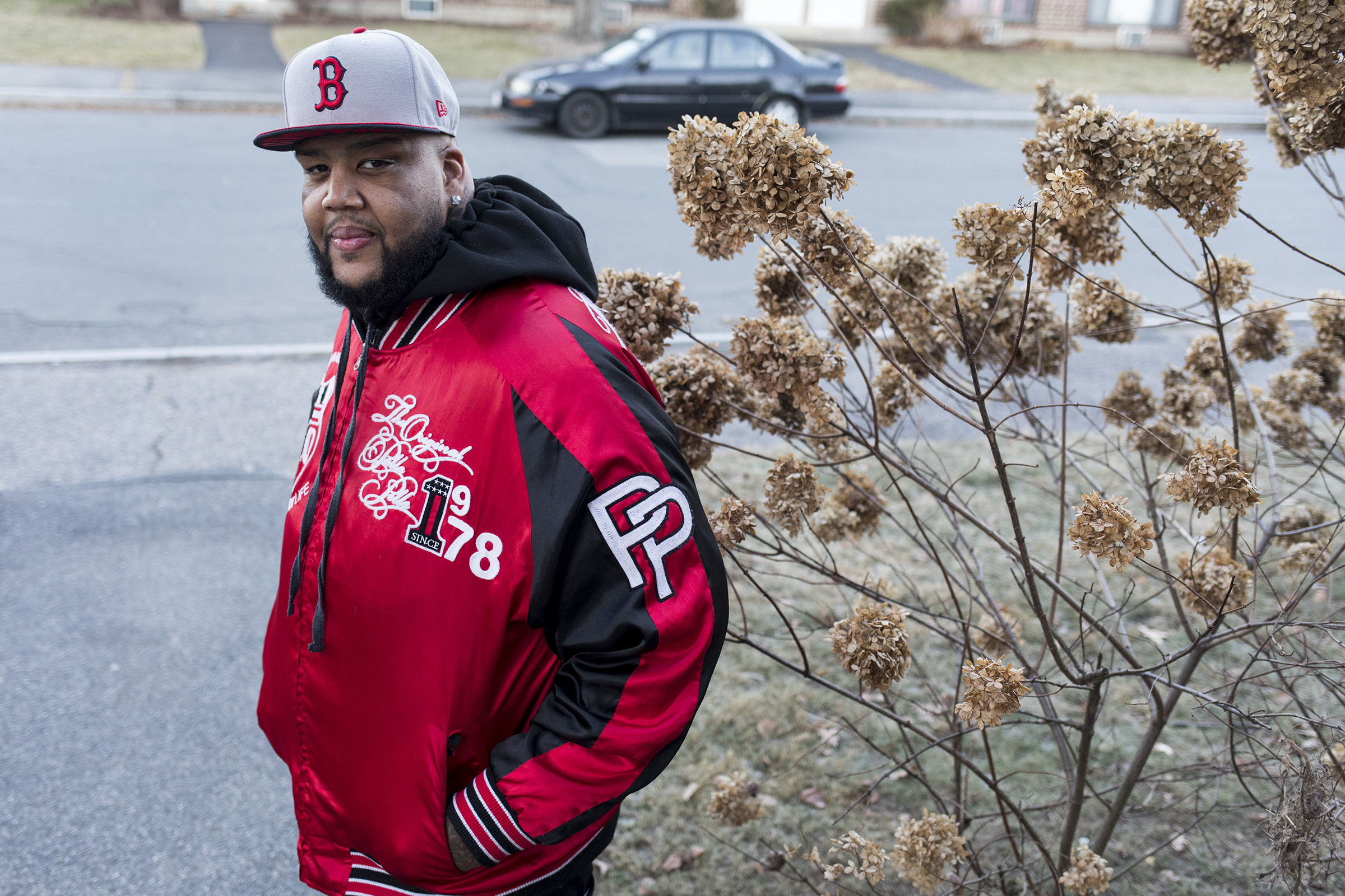 """Cheniel Garcia poses for a portrait outside of his family home in Framingham on Dec. 11, 2018. After serving four years in prison for drug charges, Cheniel Garcia changed his life. When he became friends with lifetime inmates, Garcia realized he was lucky to have an opportunity for a second chance. He focused on eating less and exercising more, he lost 212 pounds. He joined a barber education program and focused on his faith. Now, four months after being released, Garcia works full-time at the Dream Team Barber Shop and continues to stay clean. """"Every day I was in prison, I had to learn something new. I couldn't let prison shut me down."""""""