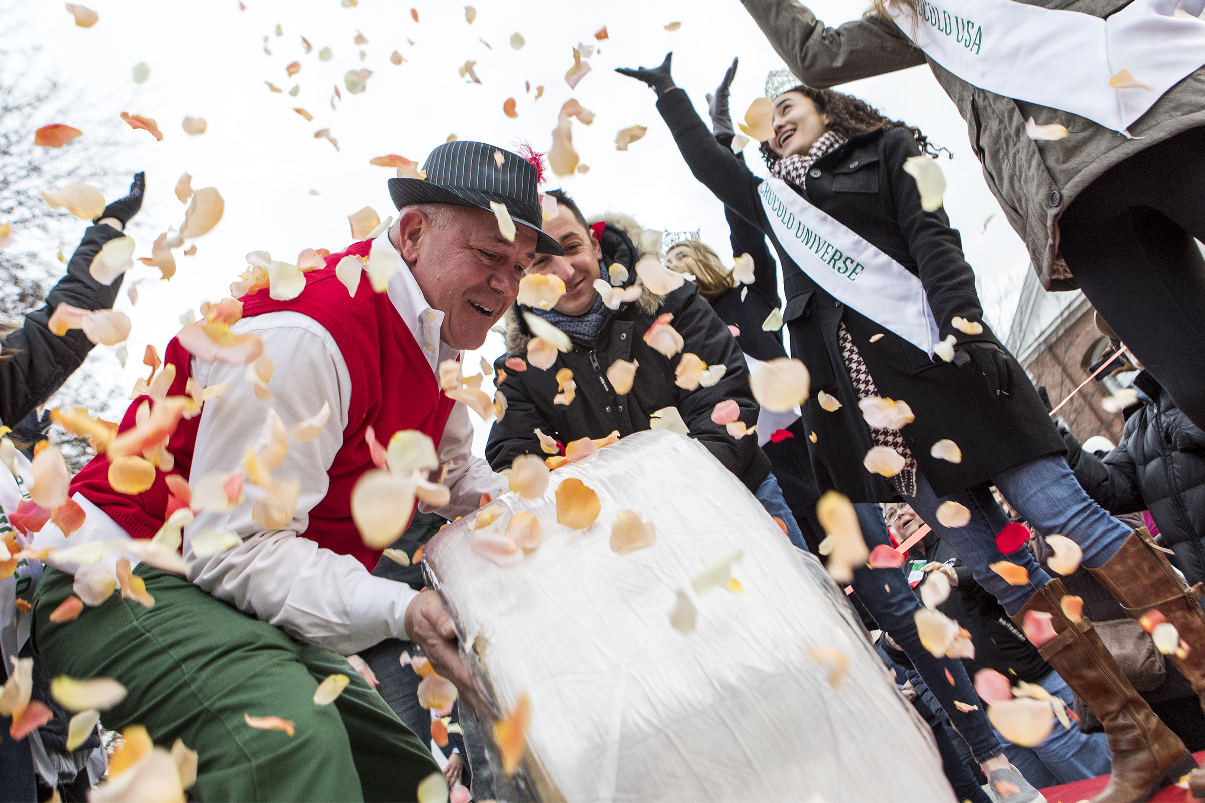 Peter Lovis, owner of the Concord Cheese Shop, rolls out the 400-pound wheel of Italian Crucolo Cheese during the 2018 Crucolo Cheese Parade in Concord on Dec. 6, 2018.