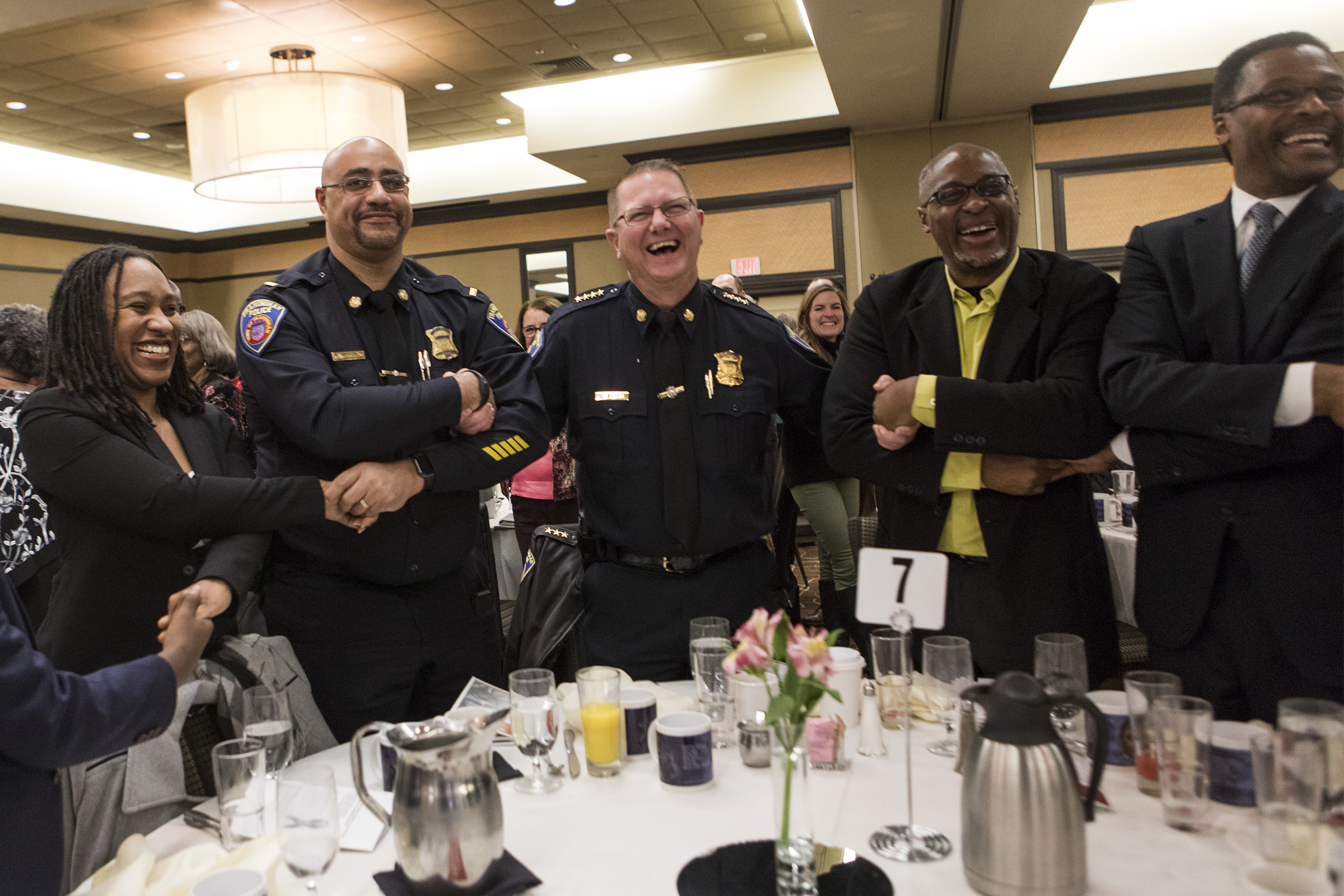 Rev. Bernadette Hickman-Maynard, Framingham Police Lieutenant Harry Wareham, Framingham Police Chief Steven Trask, WGBH News reporter Phillip Martin and Dr. John Silvanus Wilson, Jr. link arms for the closing benediction during the 32nd annual Dr. Martin Luther King, Jr. Memorial Breakfast hosted by the Greater Framingham Community Church at Verve Crowne Plaza on January 21, 2019.