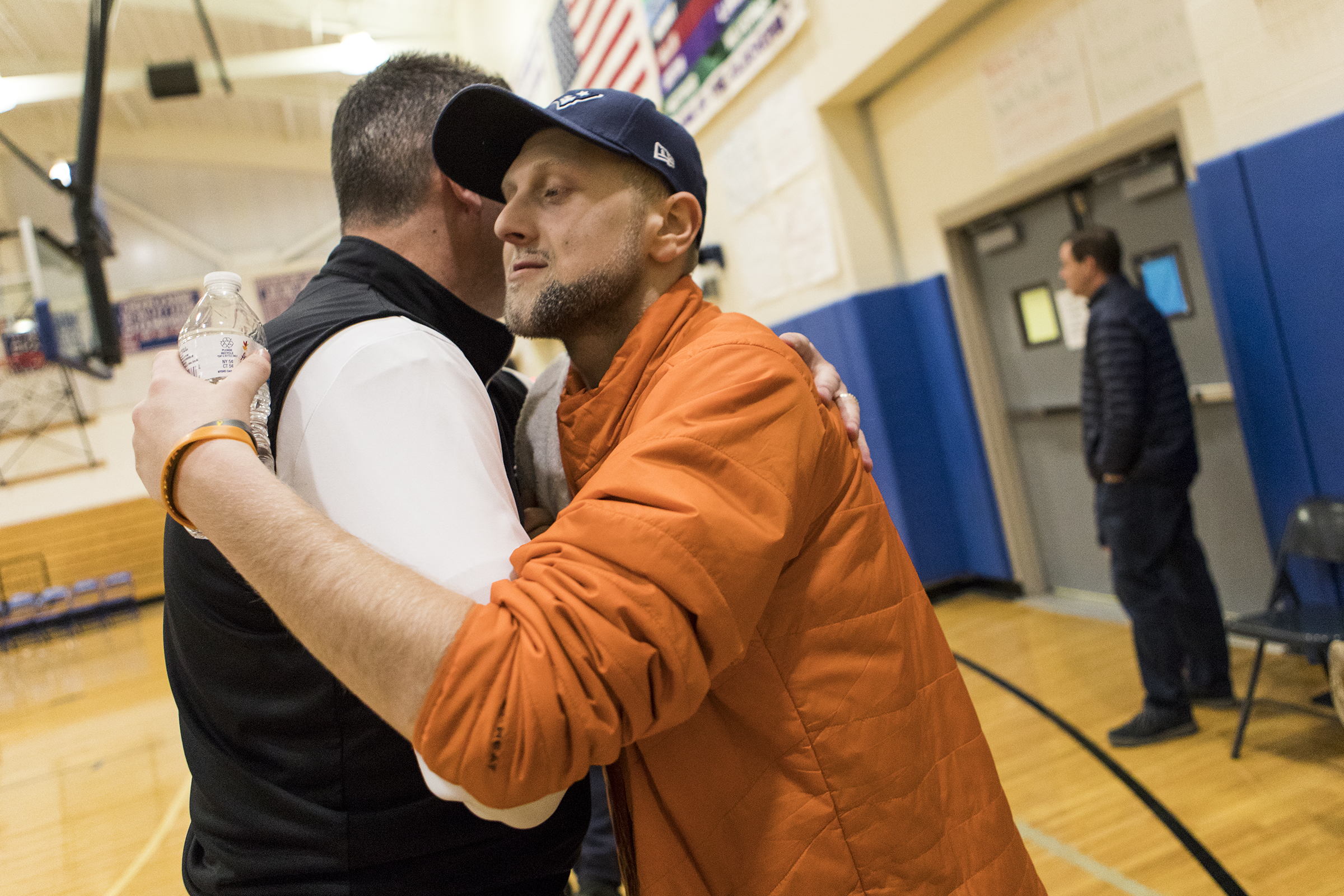 Jake Silver receives a hug during a basketball game at Ashland High School on January 18, 2019. Silver is hoping to cross items off of his bucket list, which includes seeing the Super Bowl, before his fight with osteosarcoma comes to an end.