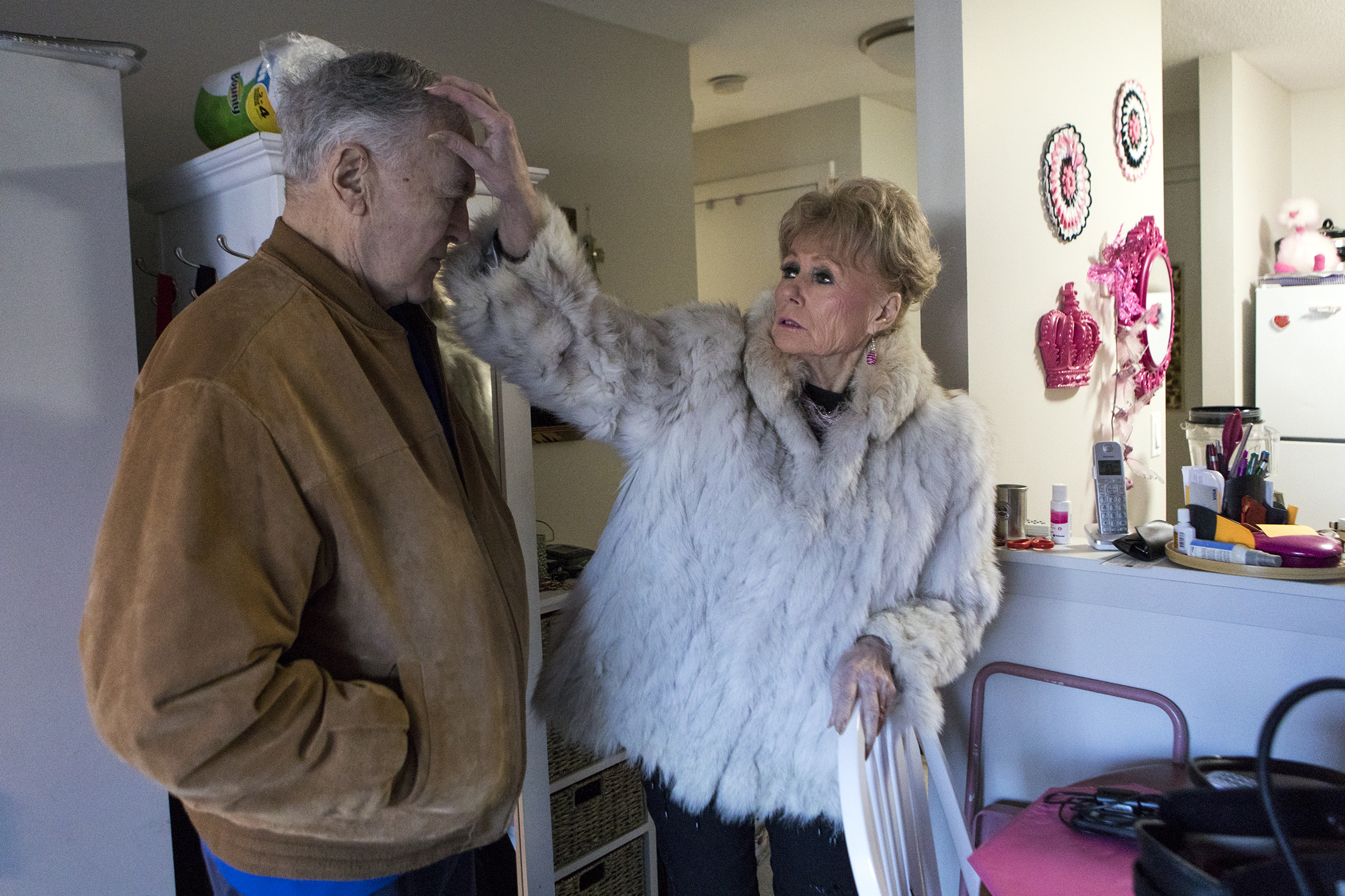 Fran Owens smoothes her husband Jim Haupt's hair before leaving their home in Stoneham on January 14, 2019.
