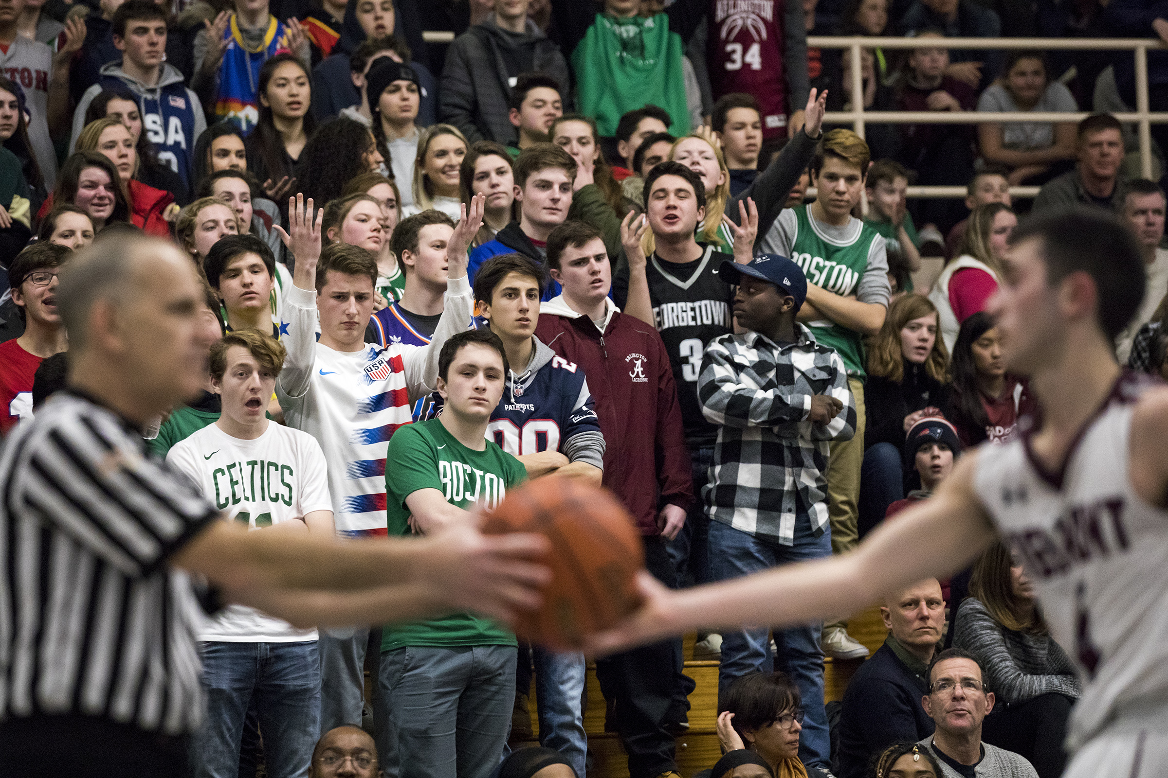 Arlington fans react after the ball is turned over to Belmont during the game in Belmont on Mar. 1, 2019.