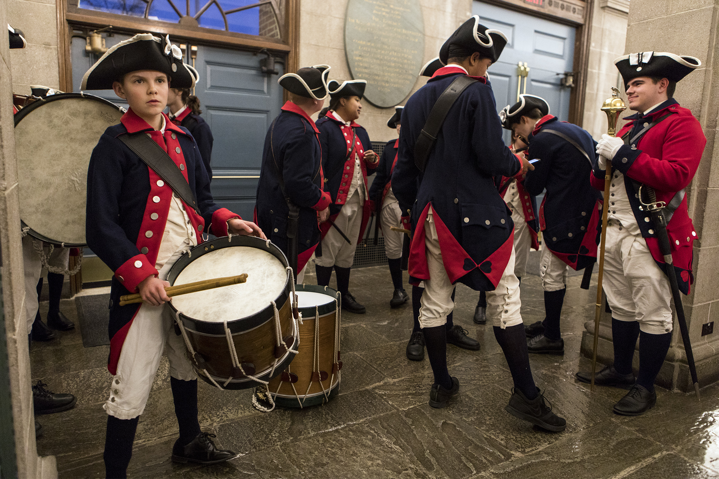 Emory Carroll, of Bedford, left, prepares to march with the William Diamond Junior Fife and Drum Corps before the annual Town Meeting at the Cary Memorial Building in Lexington on March 25, 2019