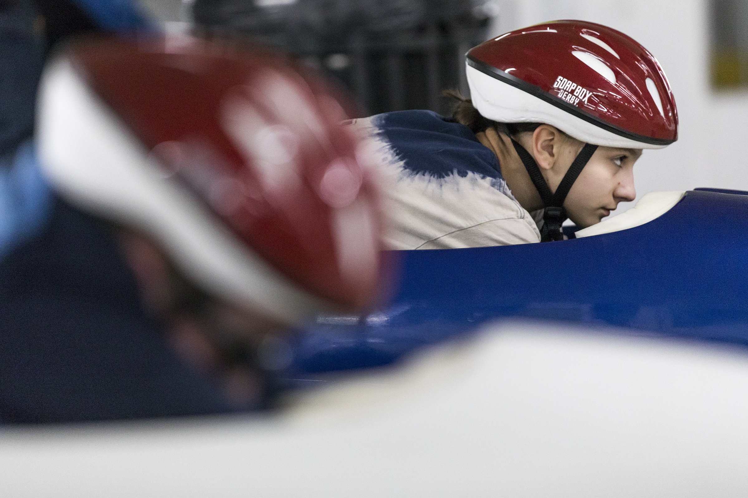 Sarah Szegedi, 13, of Belmont, looks ahead at the course before racing in the Arlington Soap Box Derby at the Cambridgeside Mall on Mar. 17, 2019.