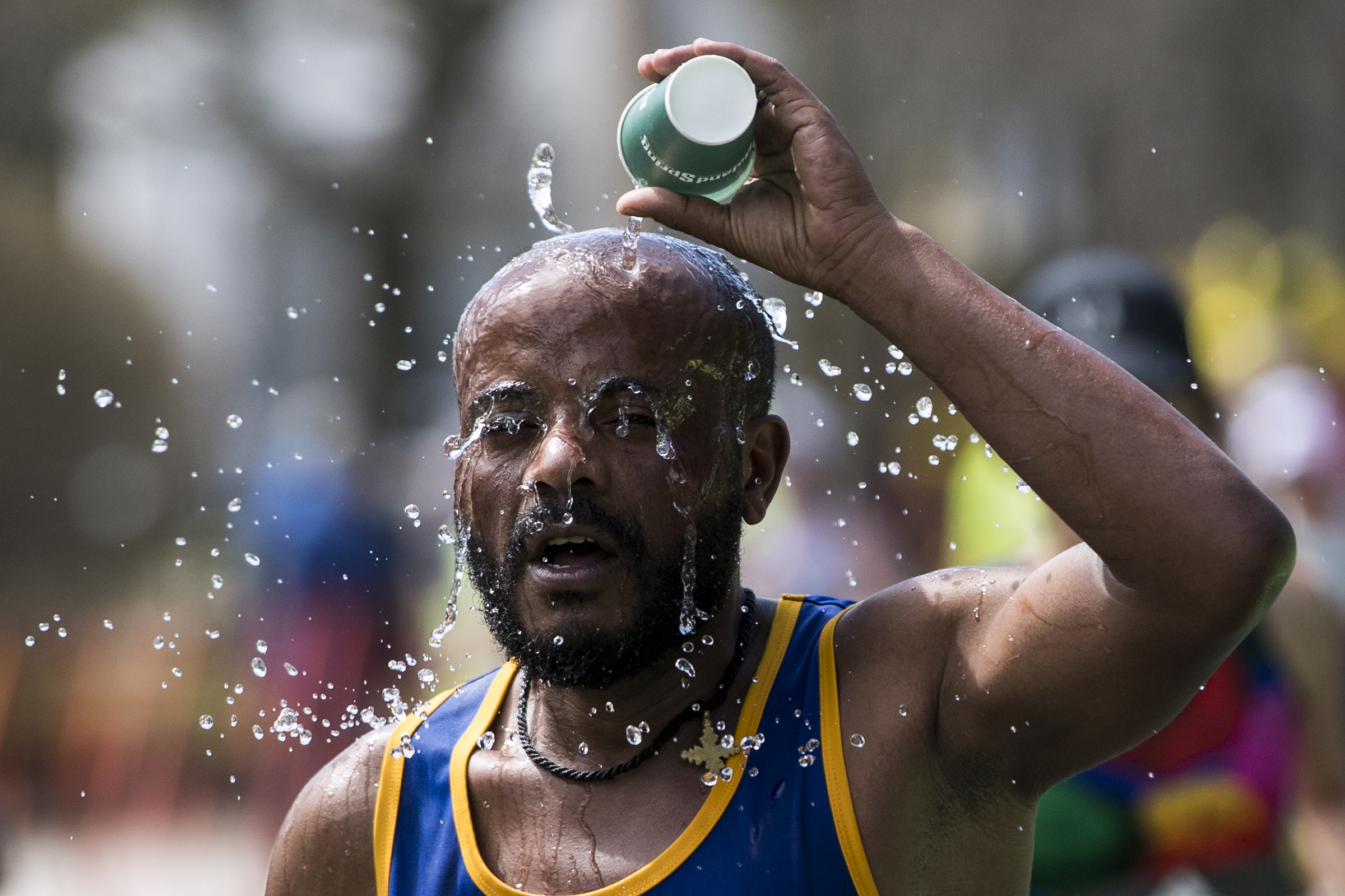 Joseph Makonnen, of California, cools off during the 2019 Boston Marathon along Commonwealth Avenue in Newton on April 15, 2019.