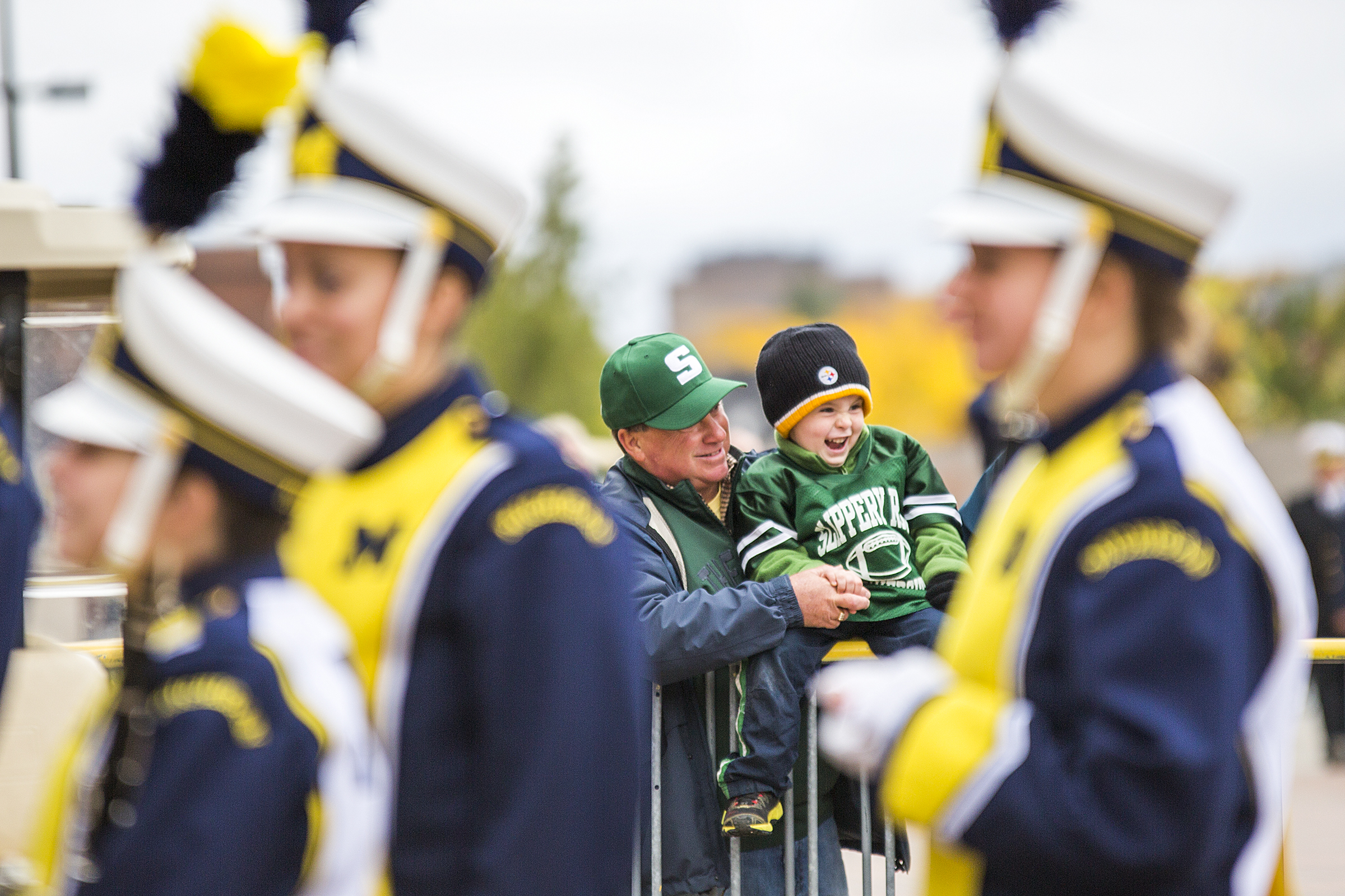 Slippery Rocks fans watch the Michigan marching band enter the Big House during the Slipper Rock vs. Mercyhurst game on October 18, 2014.