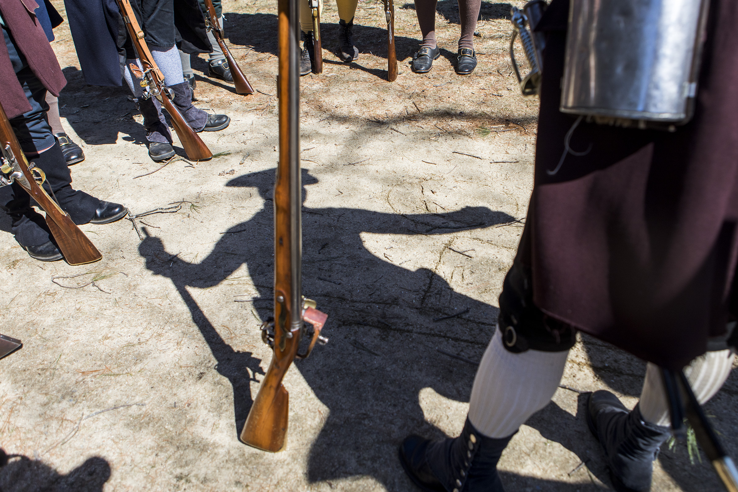 Steven Taskovics, Commander of the 4th Middlesex Militia, walks minutemen through the battle plan prior to Patriots' Day at the Minuteman National Park on Mar. 31, 2018.