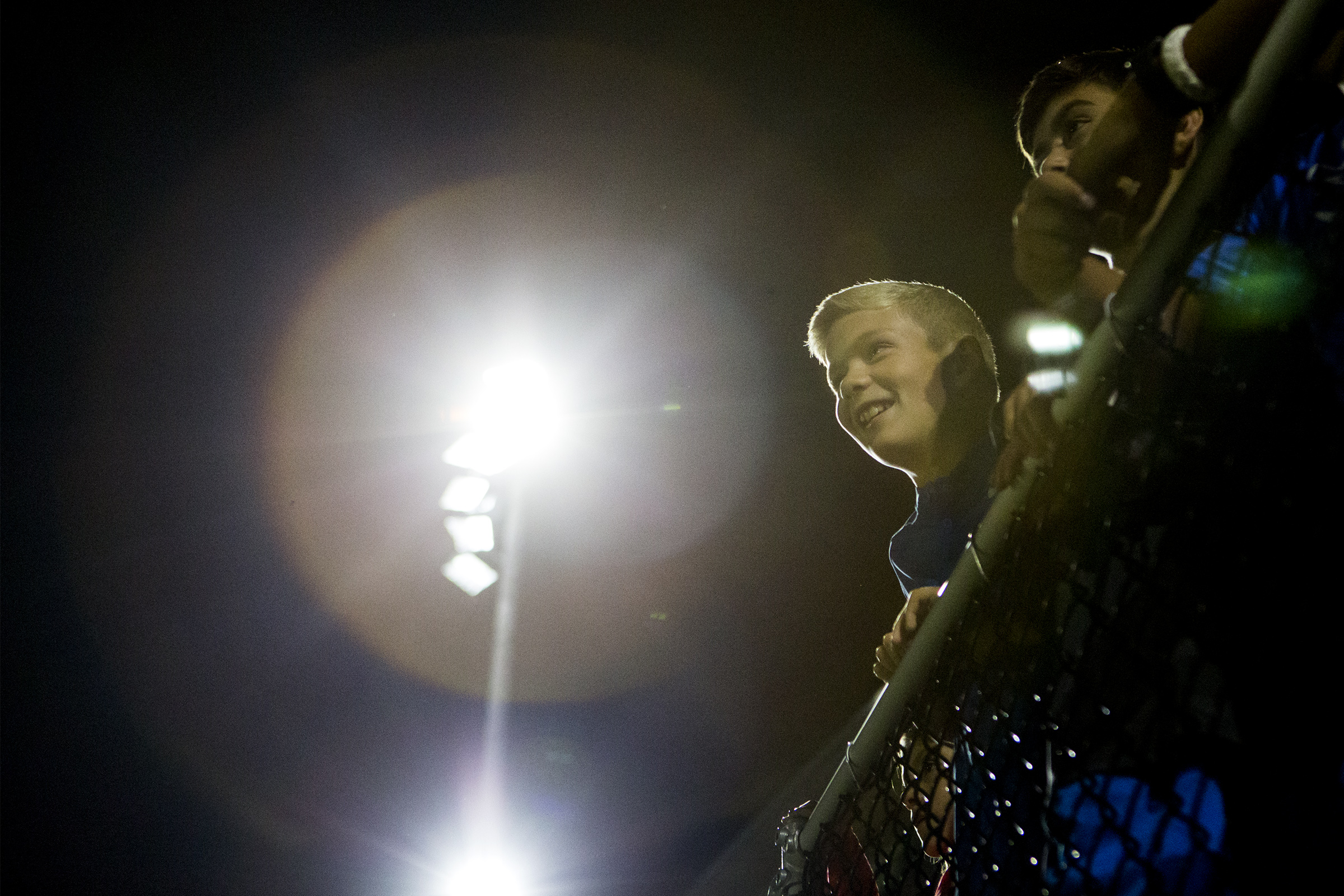 Louie Bottari, 12, watches the first football game of the season under the new lighting system installed at Knowlton Stadium in Winchester on Sept. 7, 2018.
