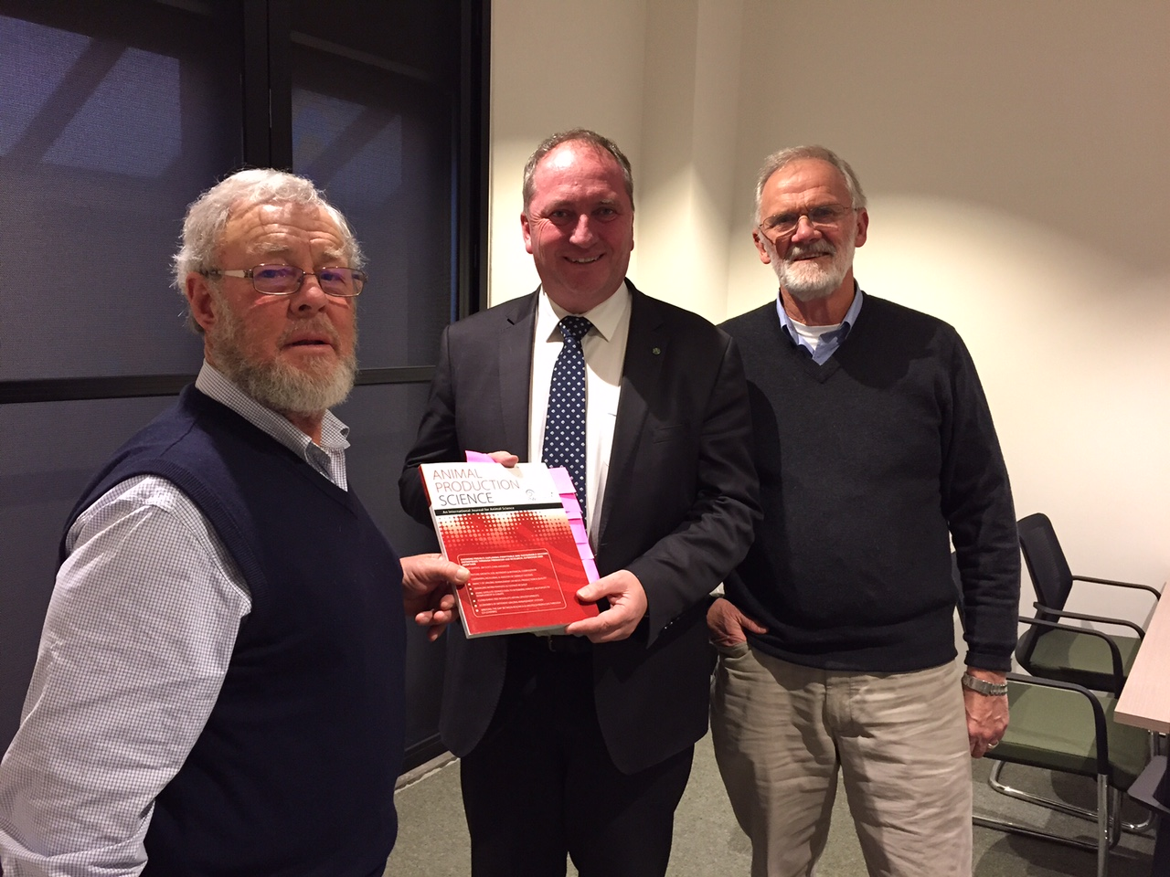 Terry Coventry (L) and Jim Scott (R) presenting Minister for Agriculture and Water Resources, Barnaby Joyce MP, with a copy of the published journal papers from the Cicerone Project