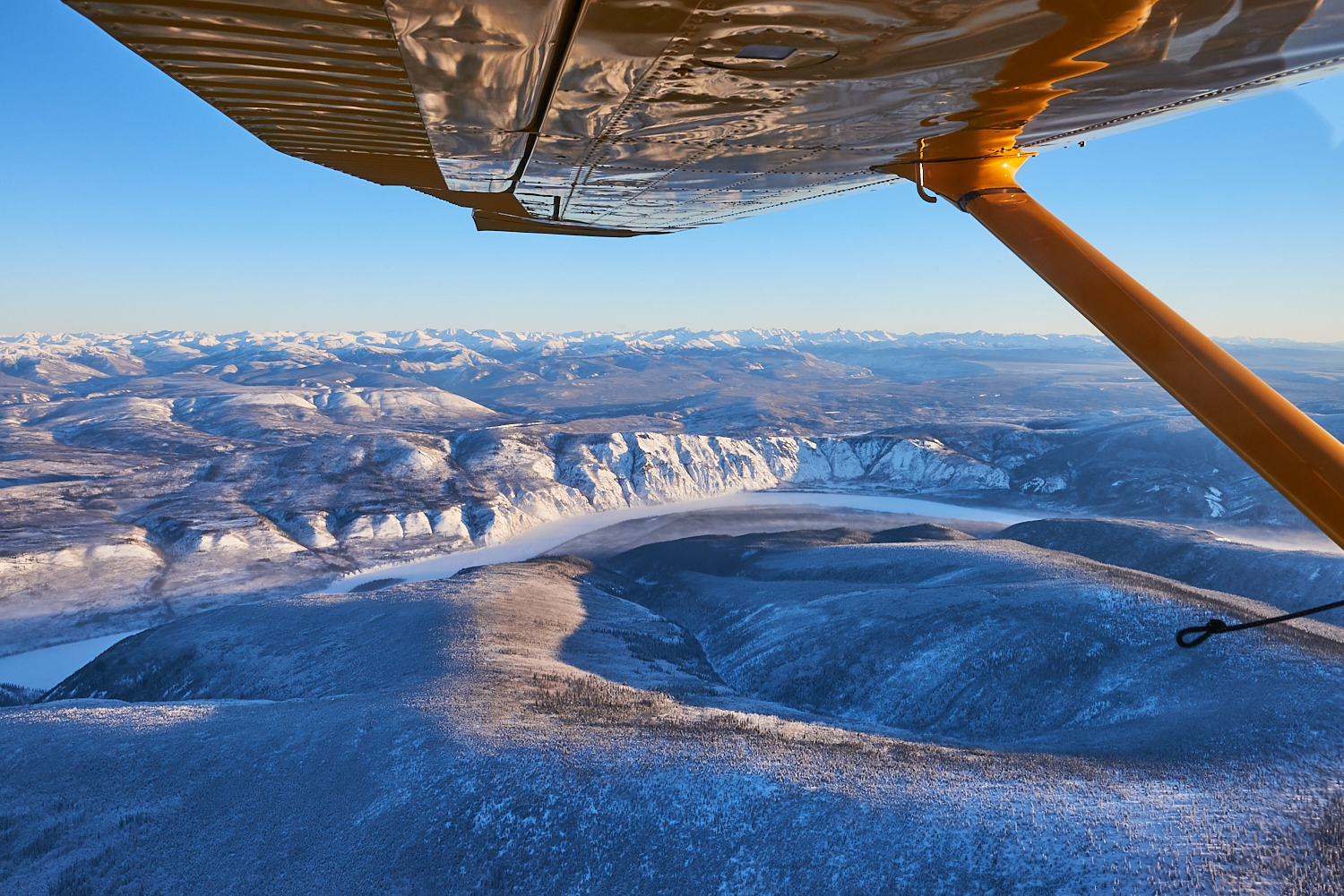Flight From Eagle To Dawson - This year I was fortunate enough to fly from Eagle to Dawson City. Eagle is a small town of about 85 people located on the Yukon river near the border of Canada and Alaska. A mid morning flight allowed for nice light and a beautiful flight.