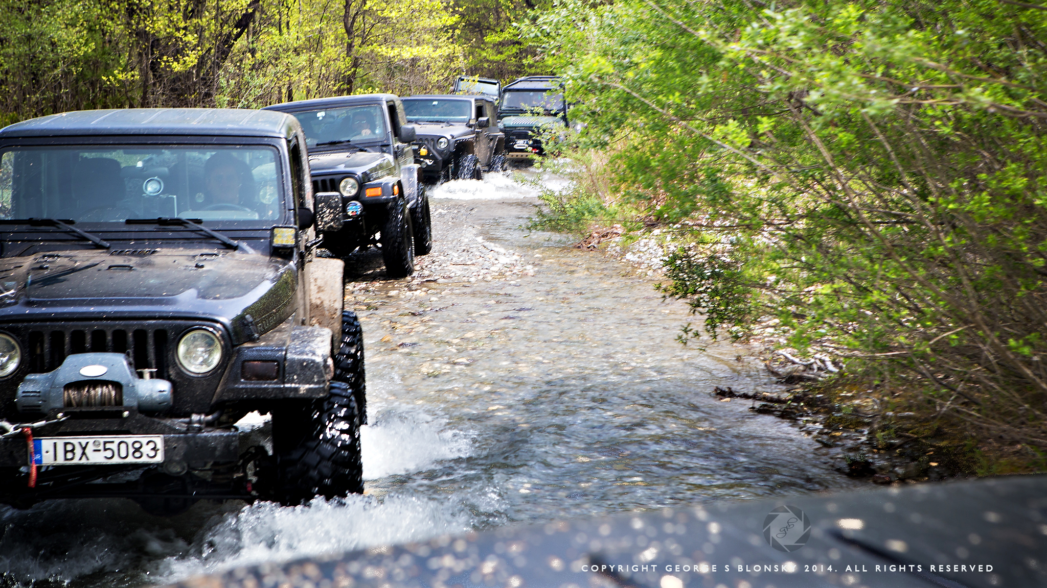 Convoy of Jeeps head up the river seeking our next location for a landscape photography session