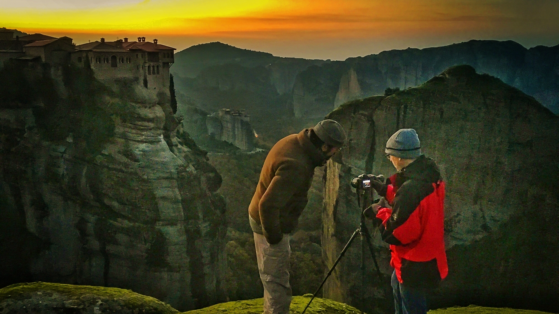 George assisting a guest as dawn spread over the horizon as we set up for our first sunrise shoot at the Meteora during our autumn landscape photography workshop to Meteora & Pindos in Greece