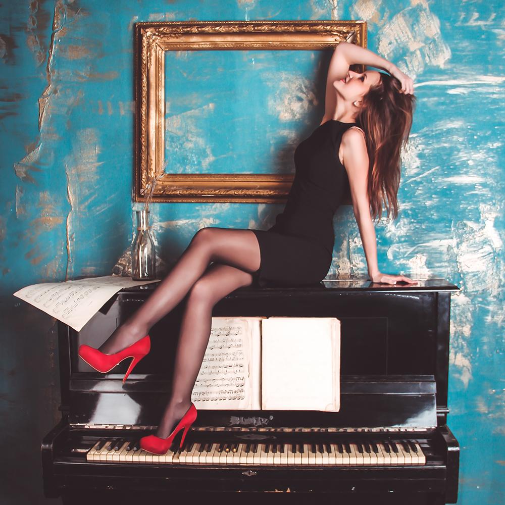 Woman on piano 1000x1000.jpg