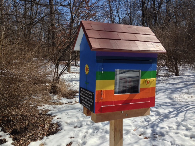 Loved the flower handle on this Little Free Library.