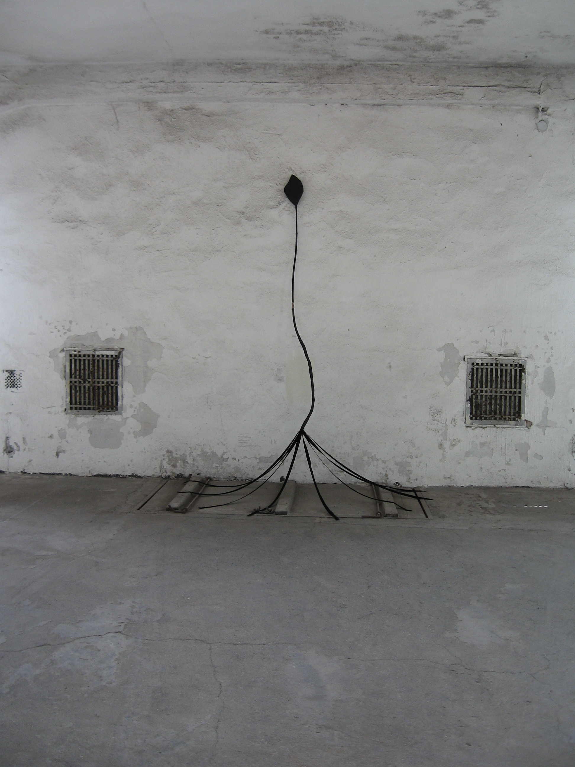 Untitled (tethered arrow), 2010, tree branch, papier-mâché, velvet ribbons, charcoal, H 7' x W 4.5' x D 3'