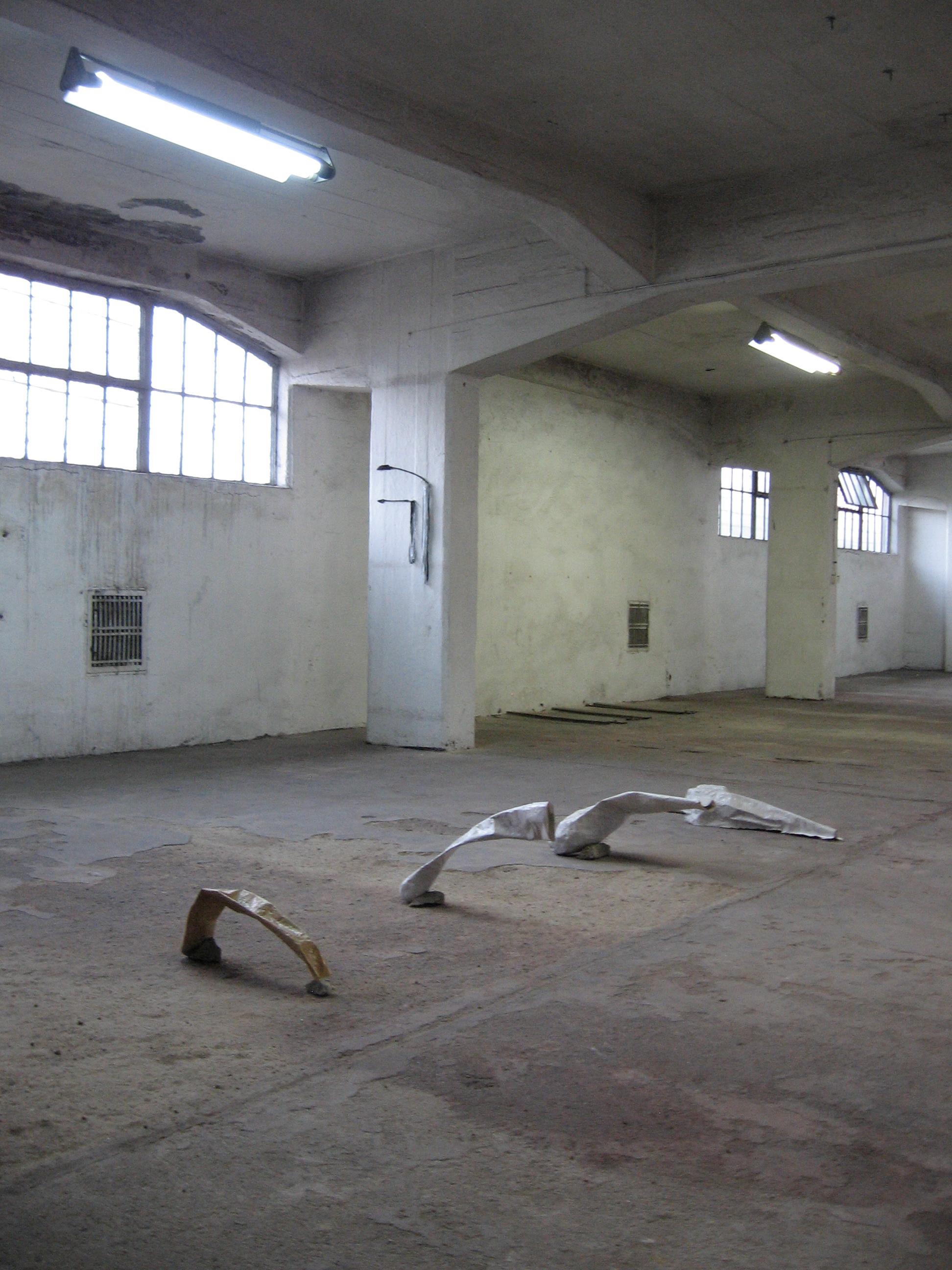 Cannons  and  Arrows  (installation view), 2010, r  ocks, papier-mâché / twigs, plastic bags, papier-mâché, charcoal, d  imensions variable