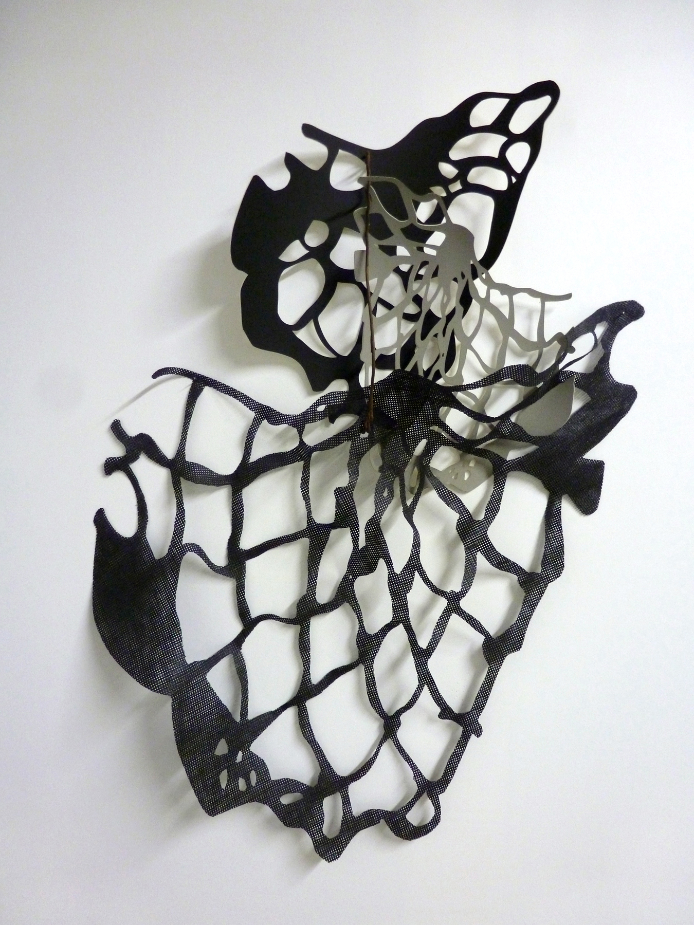 """Gaps Full of Potential #4 , 2015,hand-cut faux leather foam, rubber screen, found steel, 24"""" x 34"""" x 6""""."""