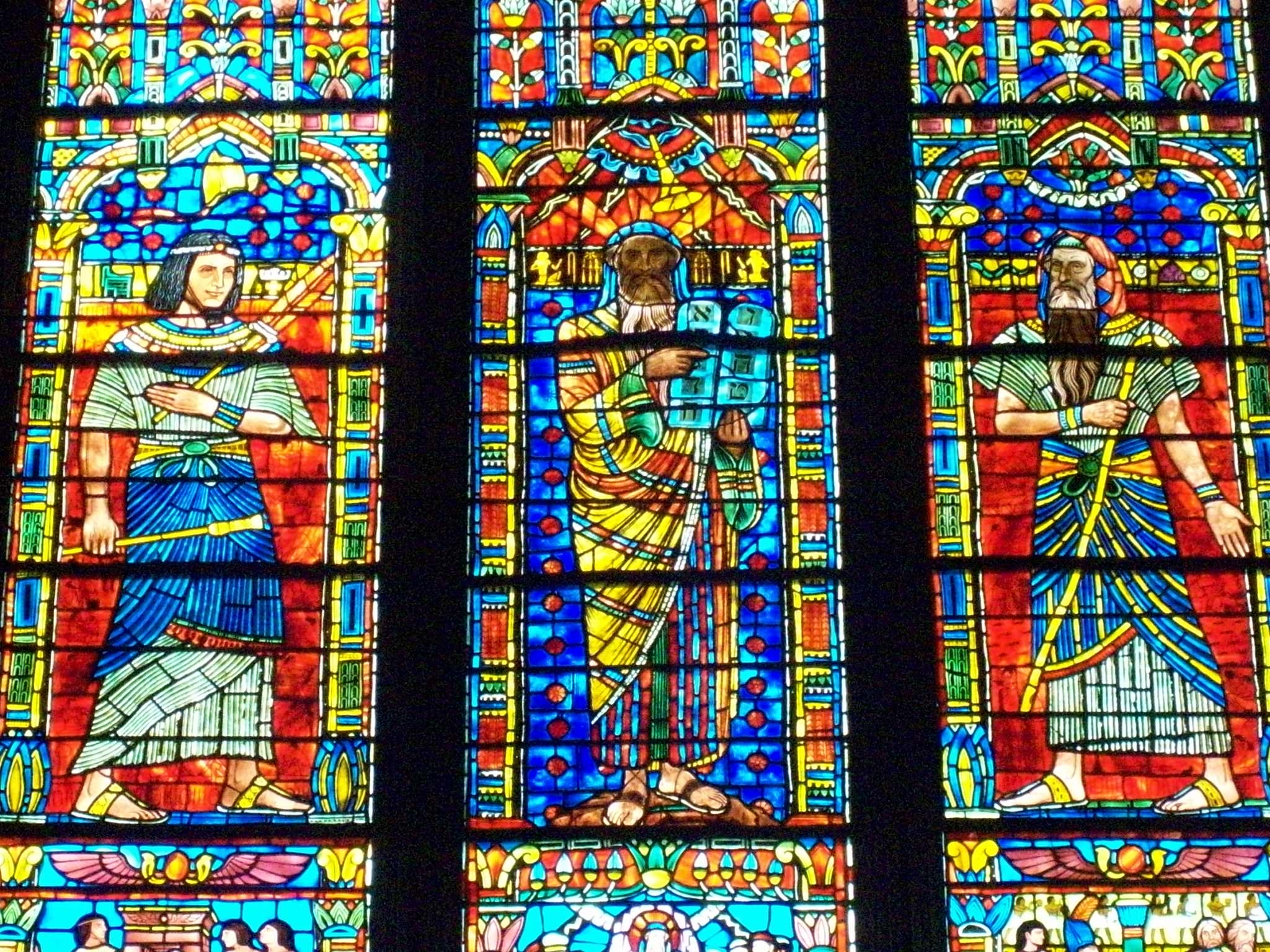 Photograph taken at the Washington National Cathedral of the Moses window by Lawrence Saint This window depicts the three stages of the life of Moses, each of them being 40 years long. The first 40 years is depicted in the left panel, when Moses is a prince in Egypt. The next 40 years is depicted in the right panel, which is Moses before Pharaoh. The last 40 years depicts Moses with the 10 Commandments, representative of his time with the Israelites in the wilderness as a lawgiver.