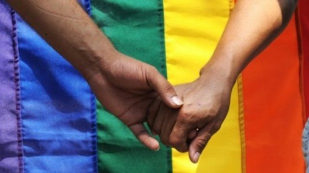 Activists-hold-hands-at-LGBT-rally-via-AFP-e1359159228805.jpg