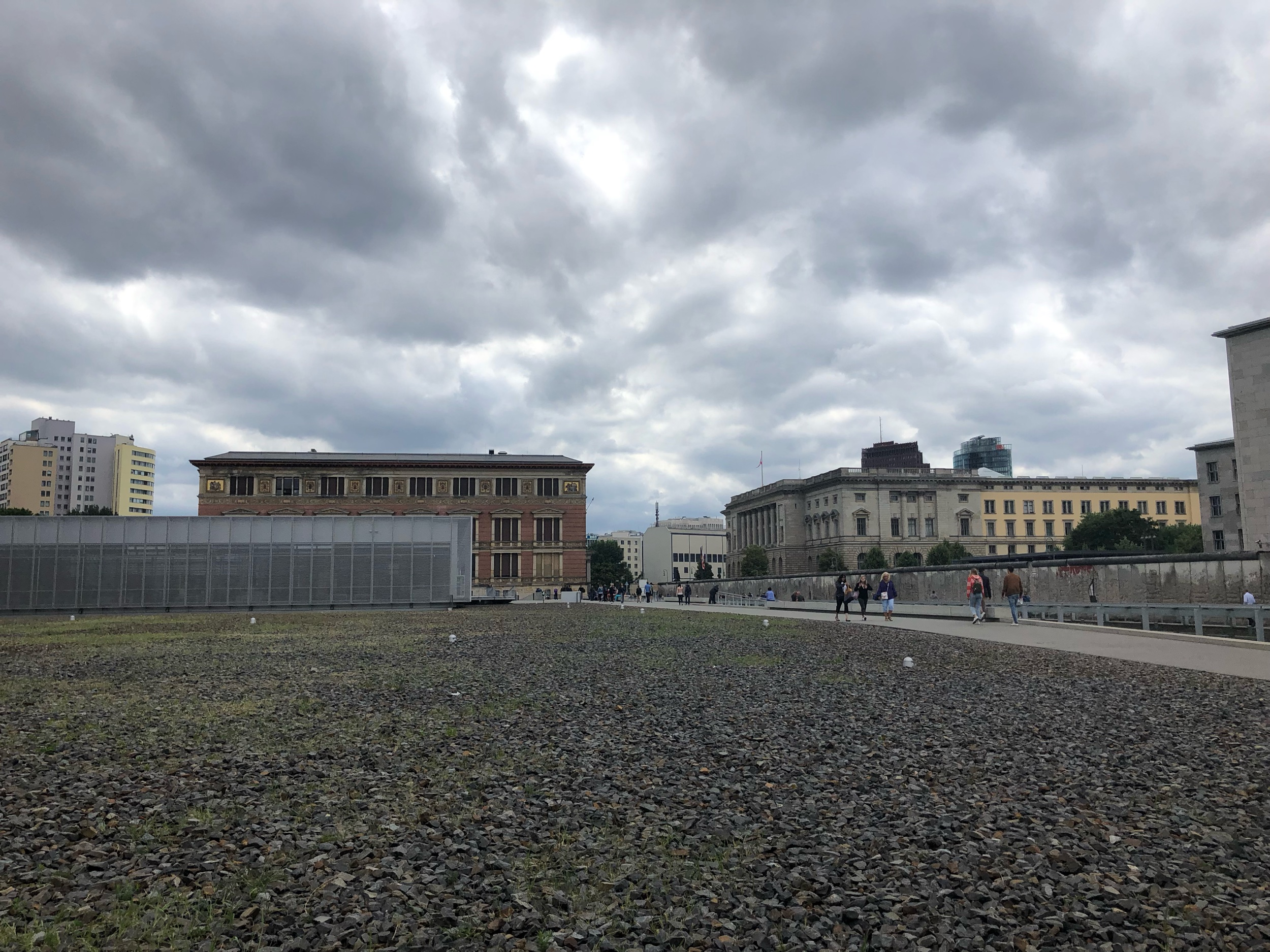 The lower silver building is the Topography of Terror. This location houses the headquarters of the Gestapo. Here you can also see a part of the Berlin Wall, and simultaneously view East and West Berlin.