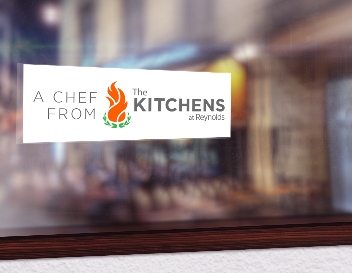 Stickers on business and restaurant windows where Kitchens alumni work