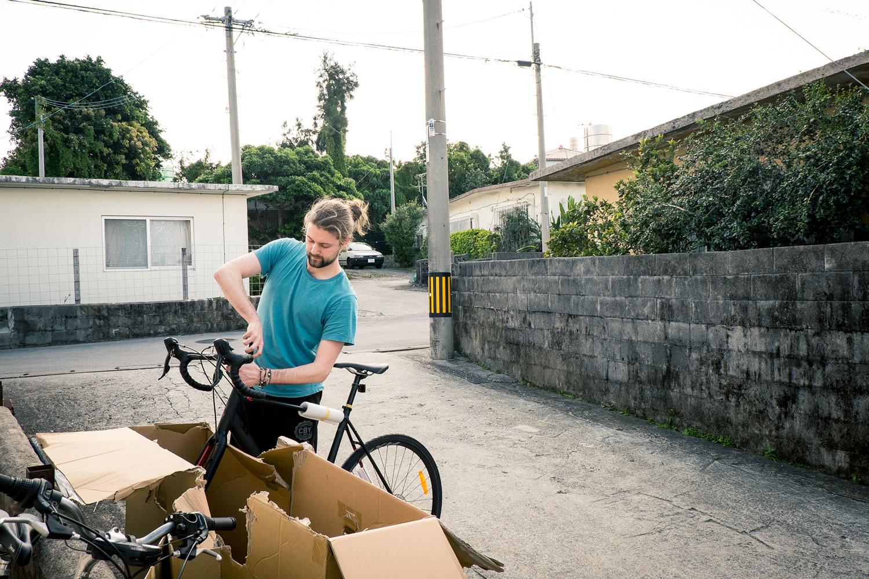 Sio assembling his bike.