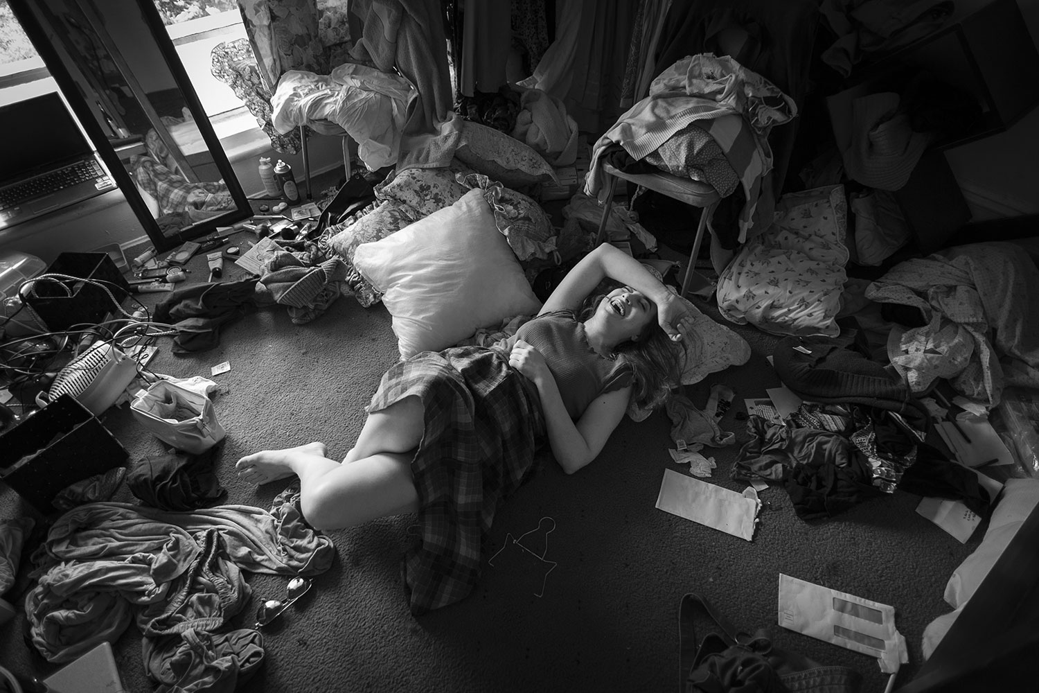 Casey in her messy room.