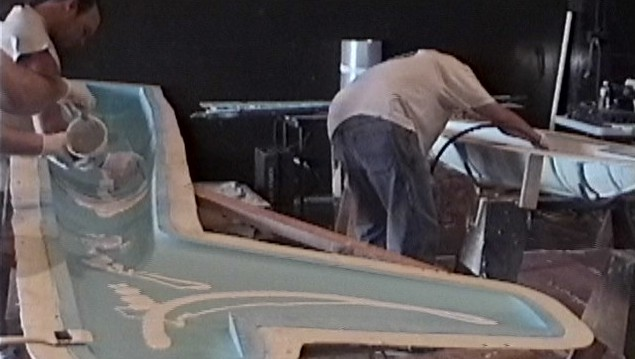 Aero Telemetry personnel applying gel coat for the XF-11 fuselage section.