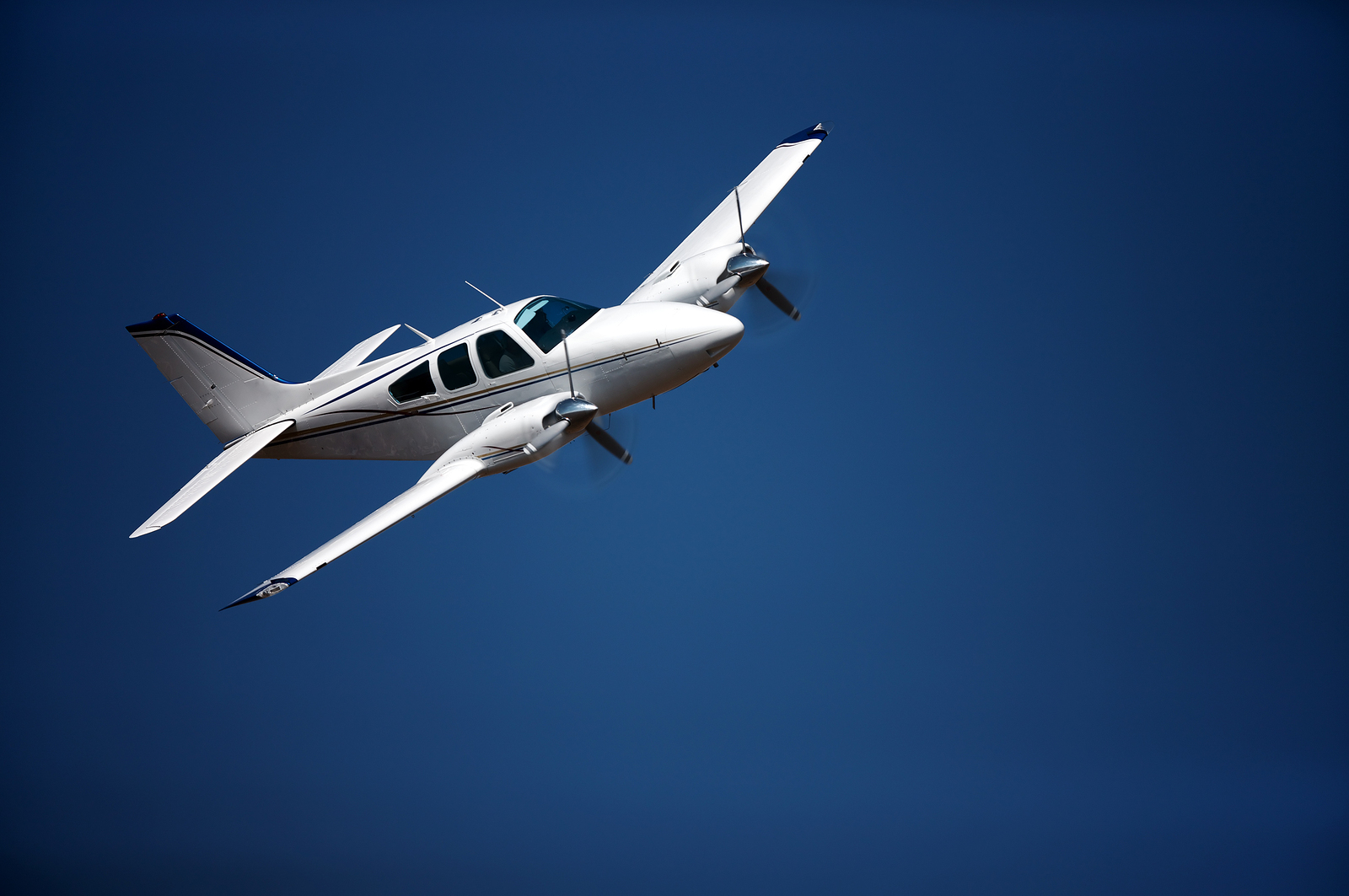 bigstock-Small-airplane-against-blue-sk-19414487.jpg