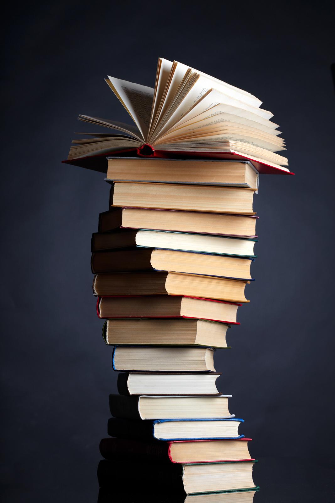 bigstock-Pile-of-books-on-a-black-backg-15350390.jpg