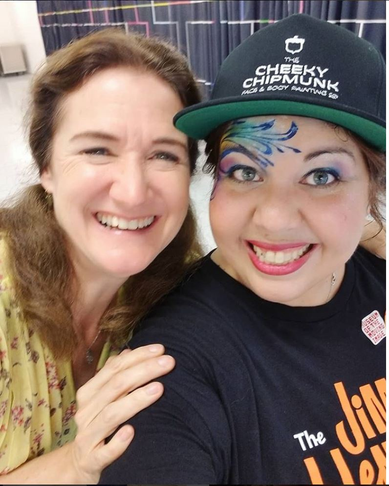 Lead artist Lenore Koppelman face painting for  the jim henson exhibit  at  the museum of the moving image . Pictured here with cheryl henson.