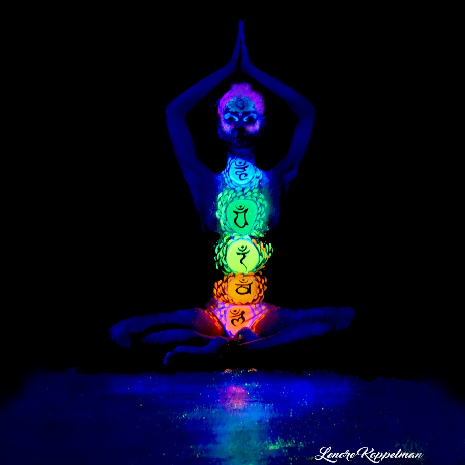 lenore-koppelman-the-cheeky-chipmunk-uv-body-painting-chakras-yoga-pose-ultraviolet-neon-glowing-face-painting-nyc-lotus-pose-position.jpg