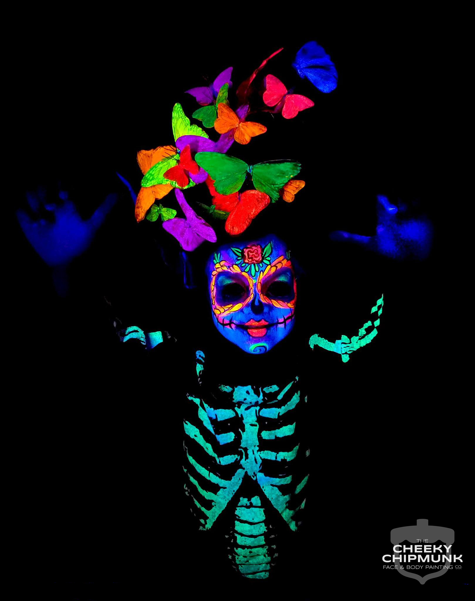 lenore-koppelman-the-cheeky-chipmunk-uv-face-body-painting-skeleton-sugar-skull-calavera-butterflies-headpiece-black-light-blacklight-neon-glow-glowing-little-girl-sophia-nyc.jpg