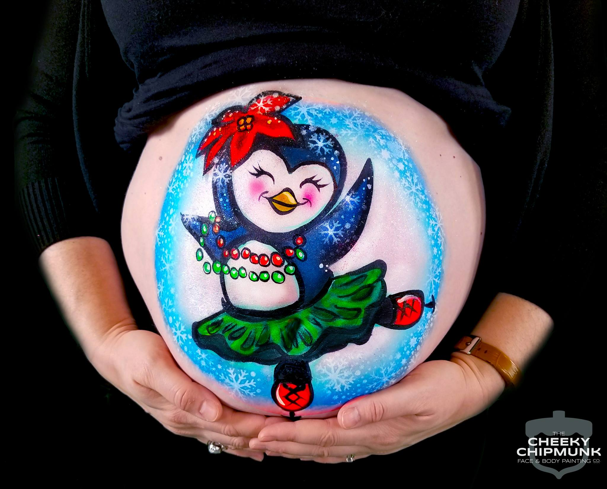 lenore-koppelman-the-cheeky-chipmunk-baby-belly-maternity-pregnancy-belly-art-penguin-ice-skating-dancing-tutu-snow-winter-cute-meredith-publishing-parents-parenting-fitpregnancy.jpg