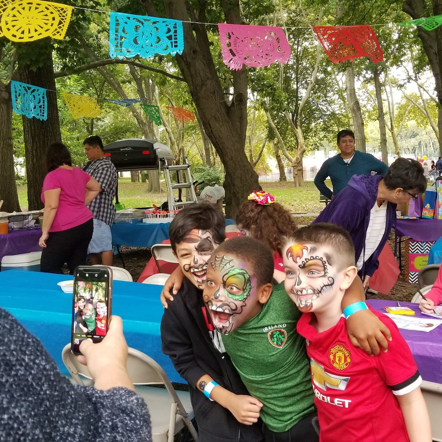 lenore-koppelman-the-cheeky-chipmunk-birthday-party-astoria-park-ny-nyc-queens-cocoa-sugar-skulls-mexican-mexico-day-of-the-dead-pixar-catarina-friends-little-boys-posting-for-photo.jpg