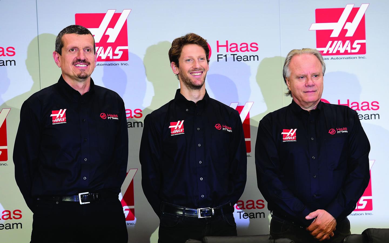 Gunther Steiner, team principal of Haas F1 Team, Romain Grosjean of France, and Gene Haas, owner of Haas F1 Team