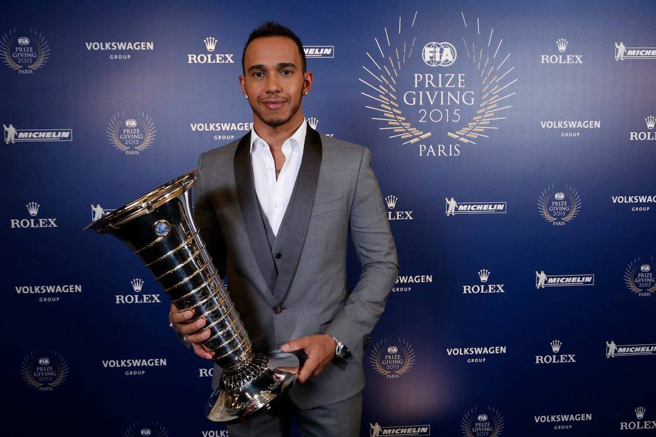 Lewis Hamilton with WDC trophy.jpg