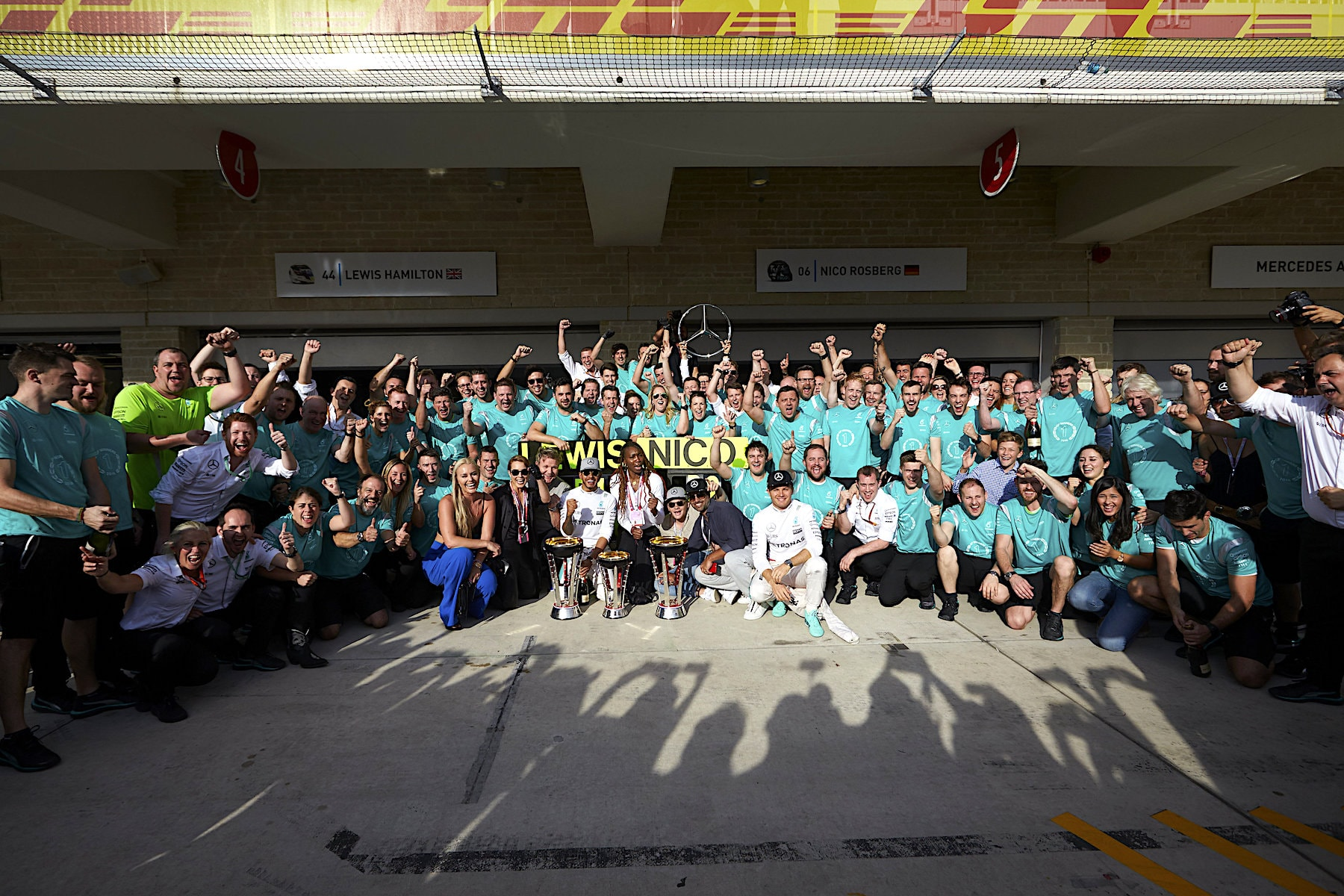 X 2016 Mercedes team celebrating 1 - 2 at 2016 USGP copy.jpg