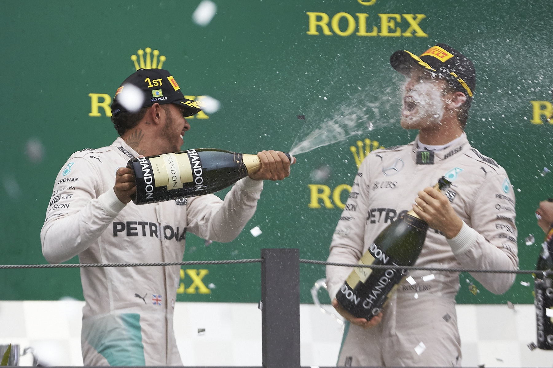 Salracing - Lewis spraying some champagne on Nico