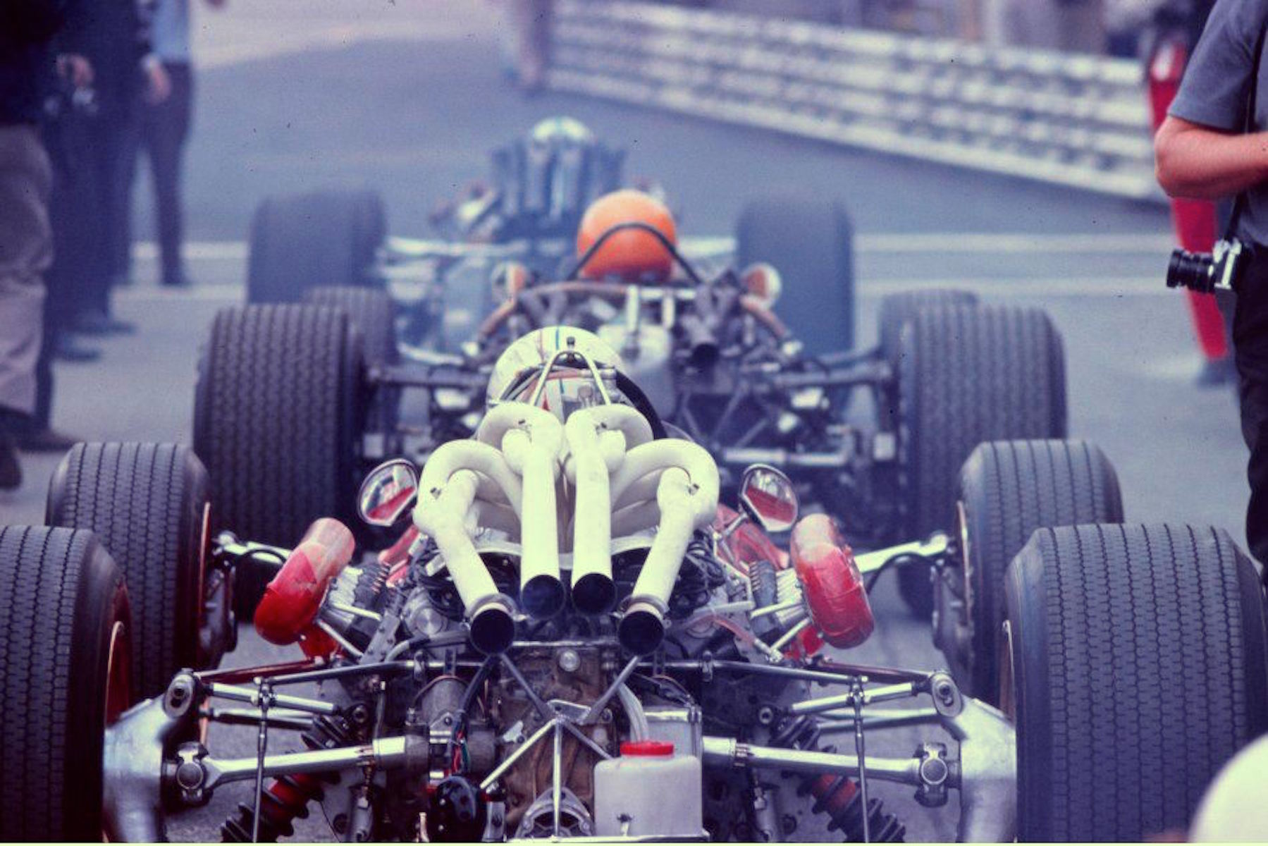 Chris Amon (Ferrari 312/67), Mike Spence (BRM P83), and John Surtees (Honda RA300) ready to leave the pits at Monza | 1967 Italian Grand Prix