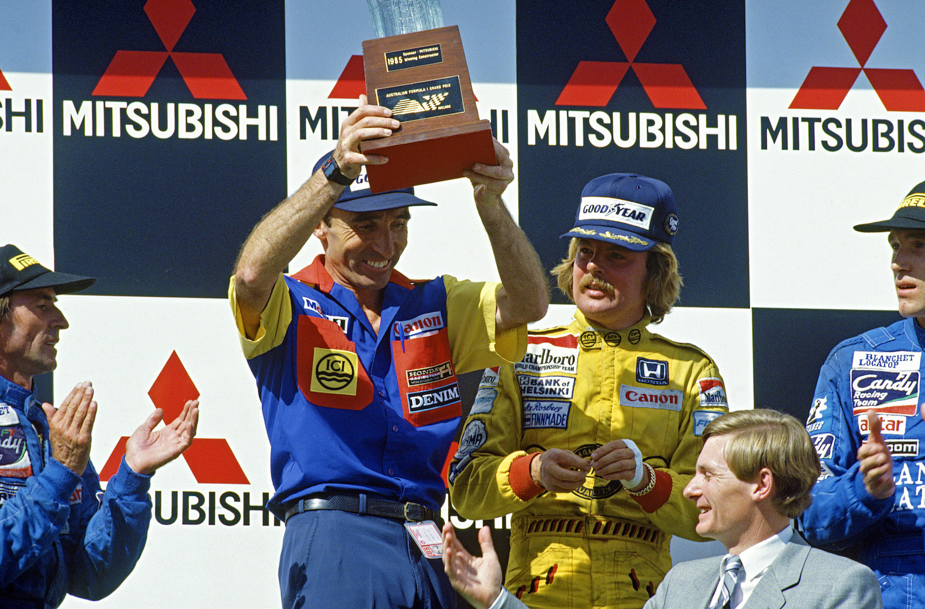 1985 Williams Frank Williams and Keke Rosberg on the top step of the podium after securing a race victory copy.jpg
