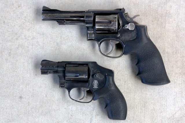Smith and Wesson Model 15 K-frame (top) and Model 442 J-frame (bottom)