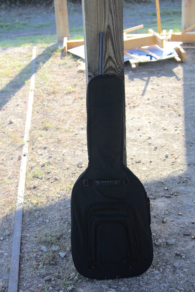 "The ""covert"" guitar case doesn't quite do the job on a shotgun as long as this Benelli Nova."