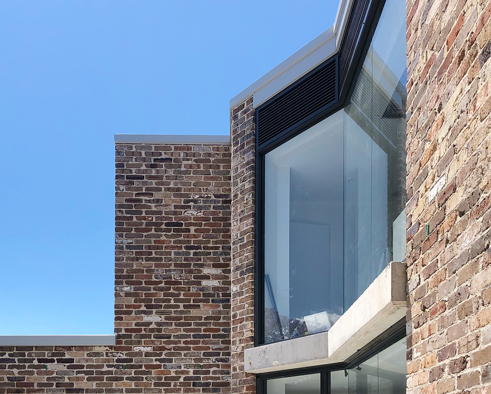 Our industrial conversion project in Marrickville is now complete, with tenants moving in over the Christmas break. We are very pleased with the compact but efficient unit layouts we were able to achieve within the shell of an old joinery factory. The project utilises recycled brick, concrete and steel to provide a low maintenance expressive external envelope.