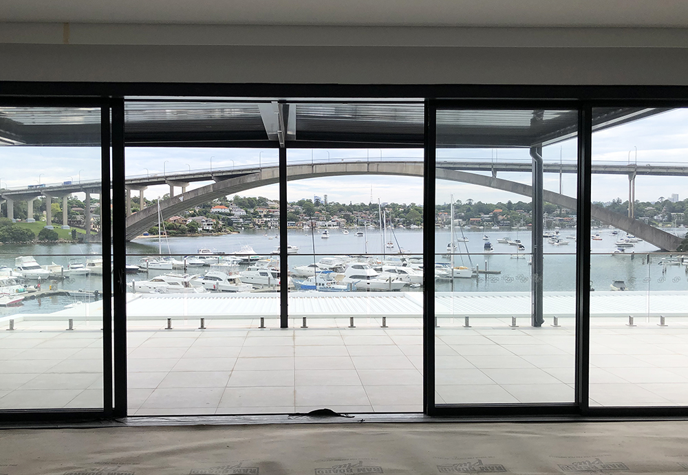 Our apartment project on the Drummoyne waterfront is nearing completion, with some internal details to finalise along with landscaping before the new residents move in. Our builder Ferrocon have done an amazing job working with a variety of site constraints to deliver this project, which includes nine luxury units with two levels of underground carparking. The majority of the units face north towards views of the Gladesville bridge and Parramatta River.