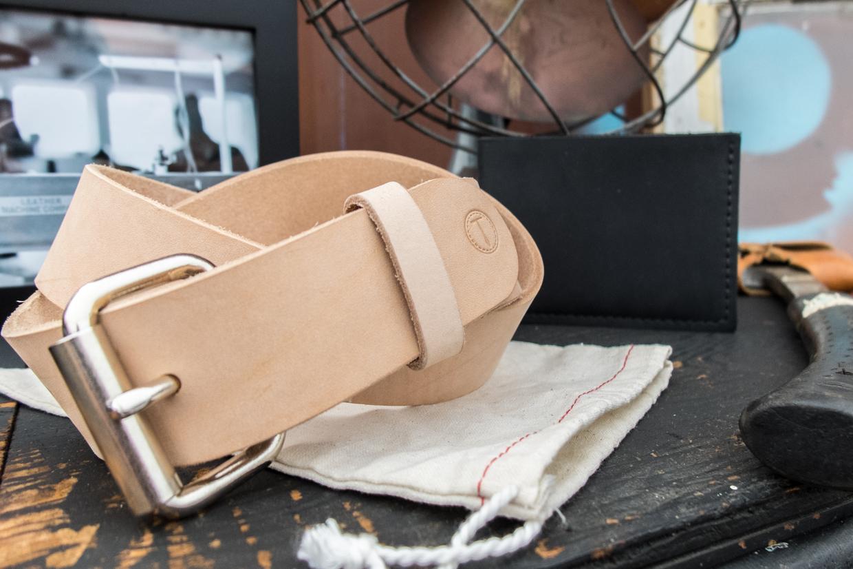 Truman veg tan belt and black bi-fold wallet.