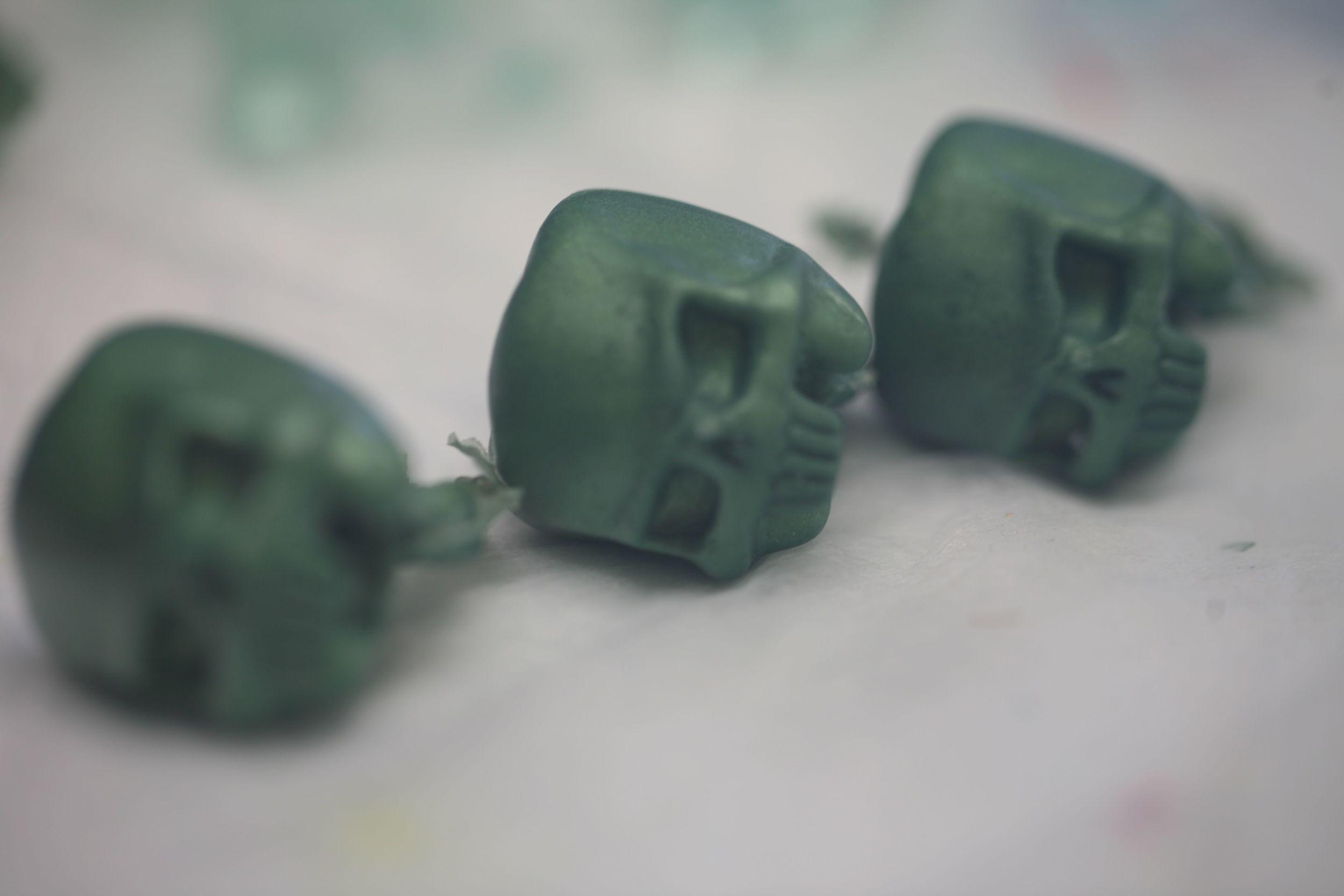 3 green heads on side.jpg