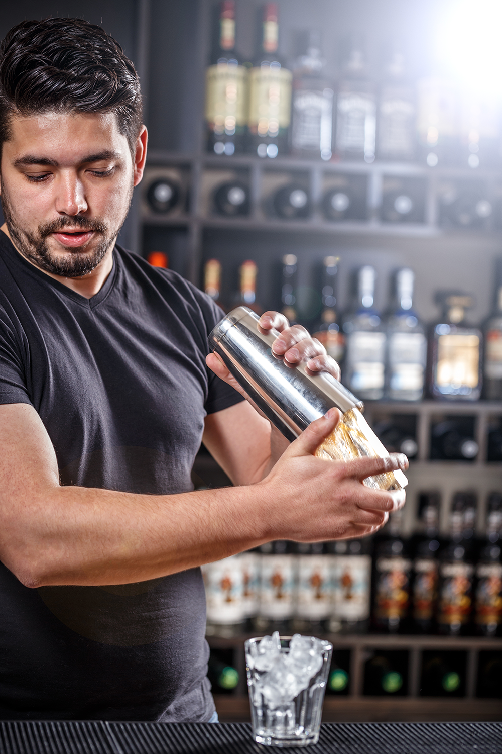 barman-is-shaking-alcohol-cocktail-PBNZ5CE.png